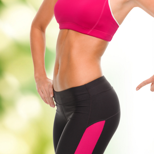 close up of sporty woman pointing at her buttocks